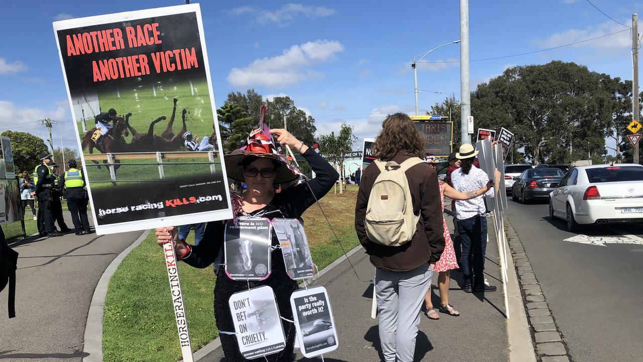 Racing protesters target punters outside Flemington Racecourse. Picture: Aneeka Simonis