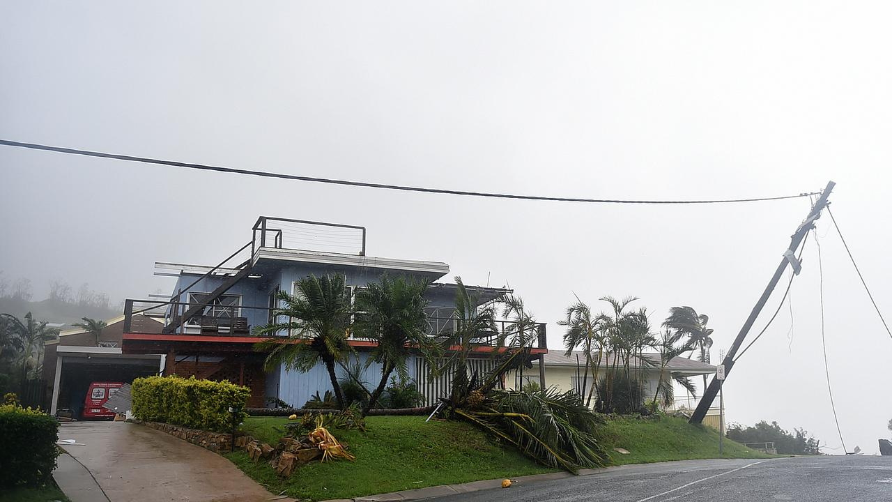 This house and powerline in Airlie Beach was among the many damaged during Cyclone Debbie.