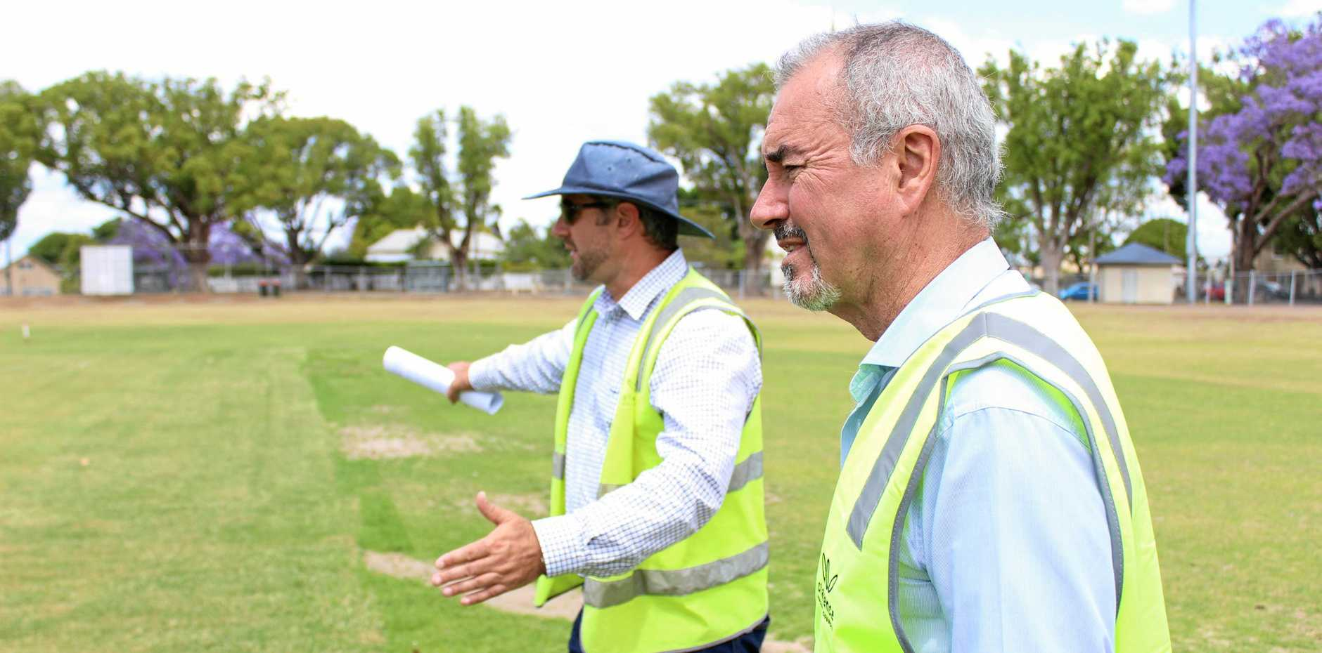 FLAT DECK: Clarence MP Chris Gulaptis inspects the freshly laid wicket at Ellem Oval with Council open spaces coordinator David Sutton.