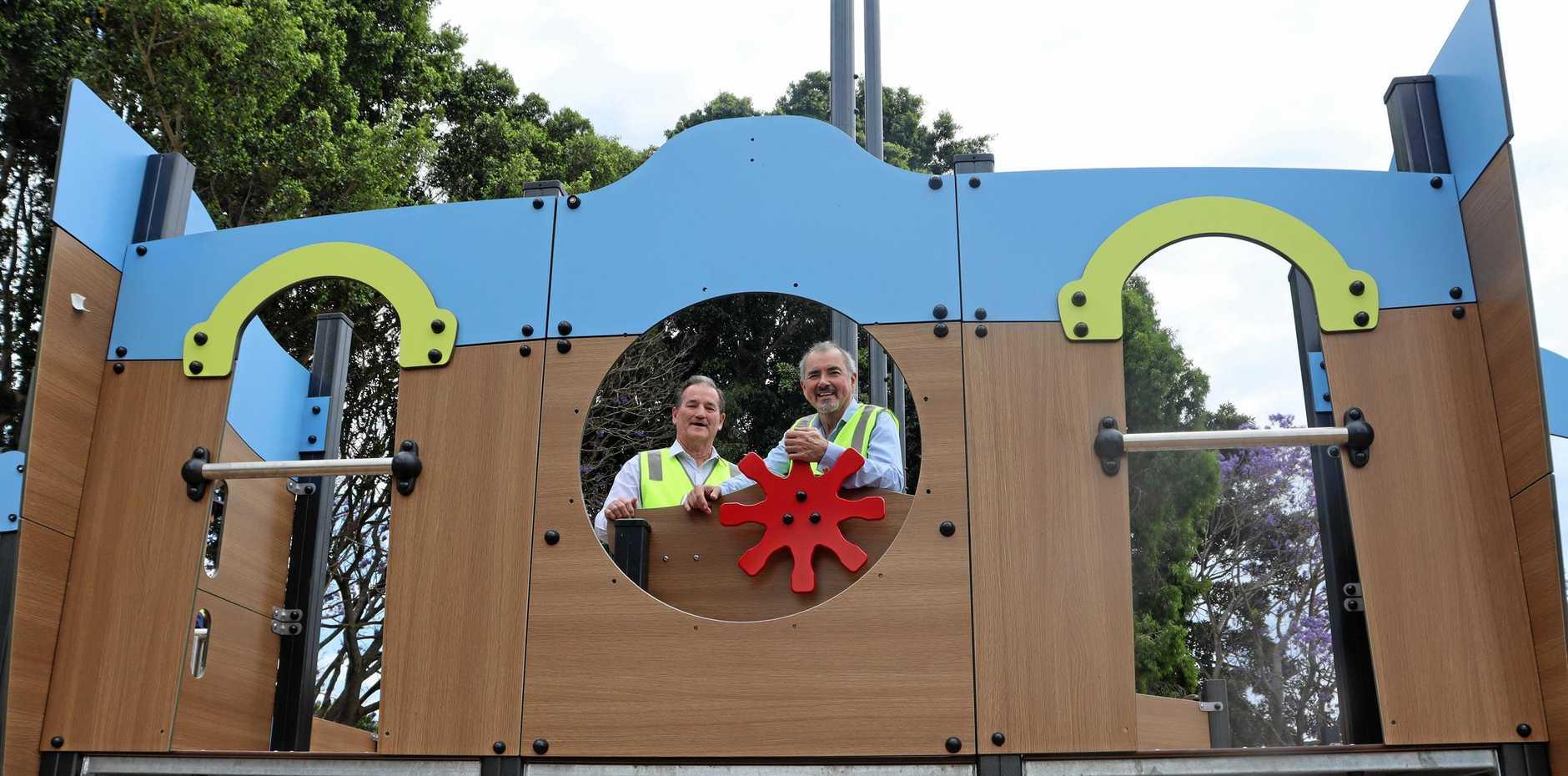 PLAY TIME: Mayor Jim Simmons and Clarence MP Chris Gulaptis enjoy the new play equipment at Jacaranda Park.