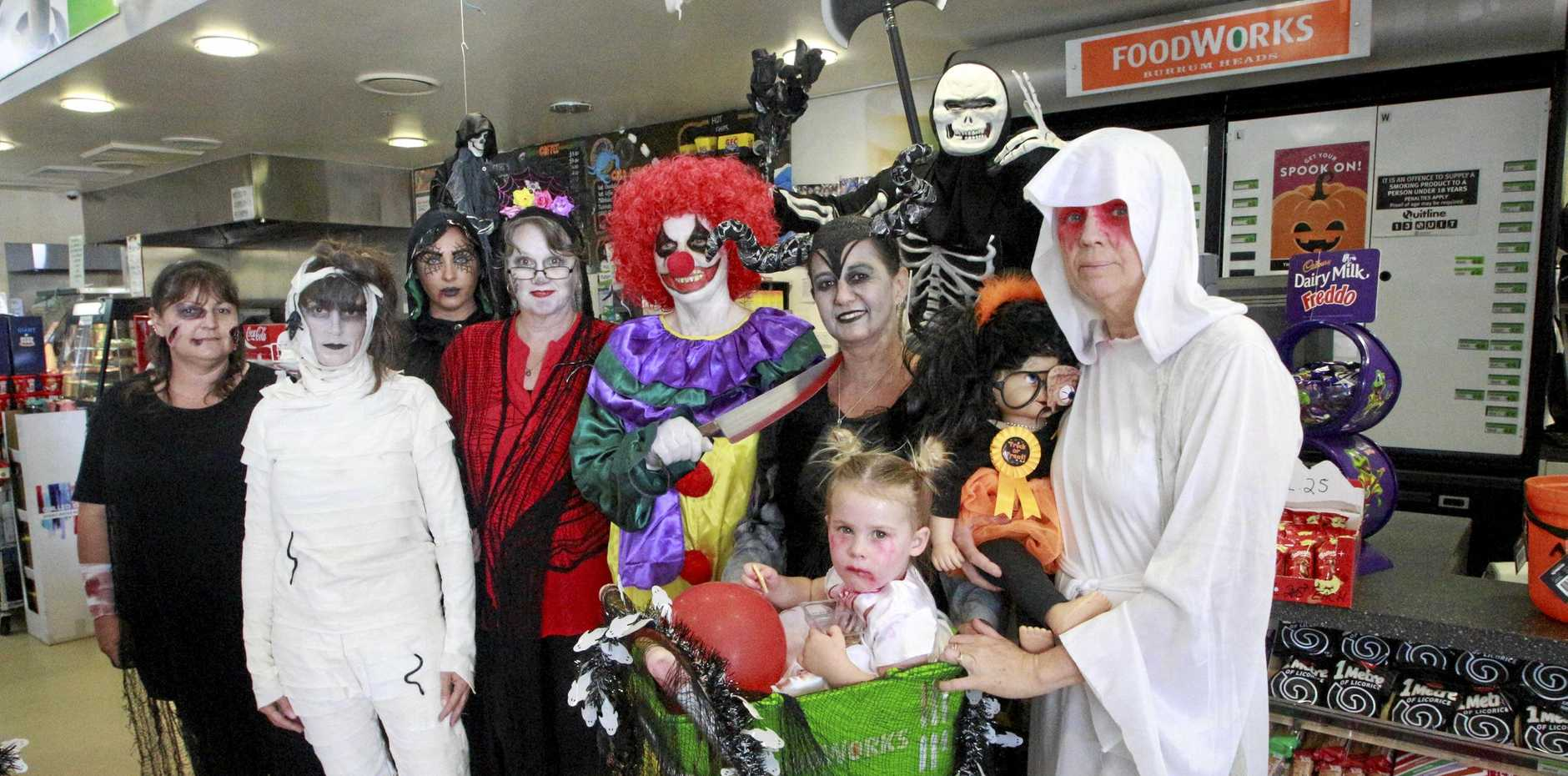 HAVING FUN: Foodworks Burrum Heads and Post Office staff Jo Smith, Heather Attwell, Brooke Guest, Deb Humphrey, Sue Donohoe, Nicole Maher, Zaidy Guest, Susan Vaughan and Shane Vaughan (background) were having some Halloween fun with customers.