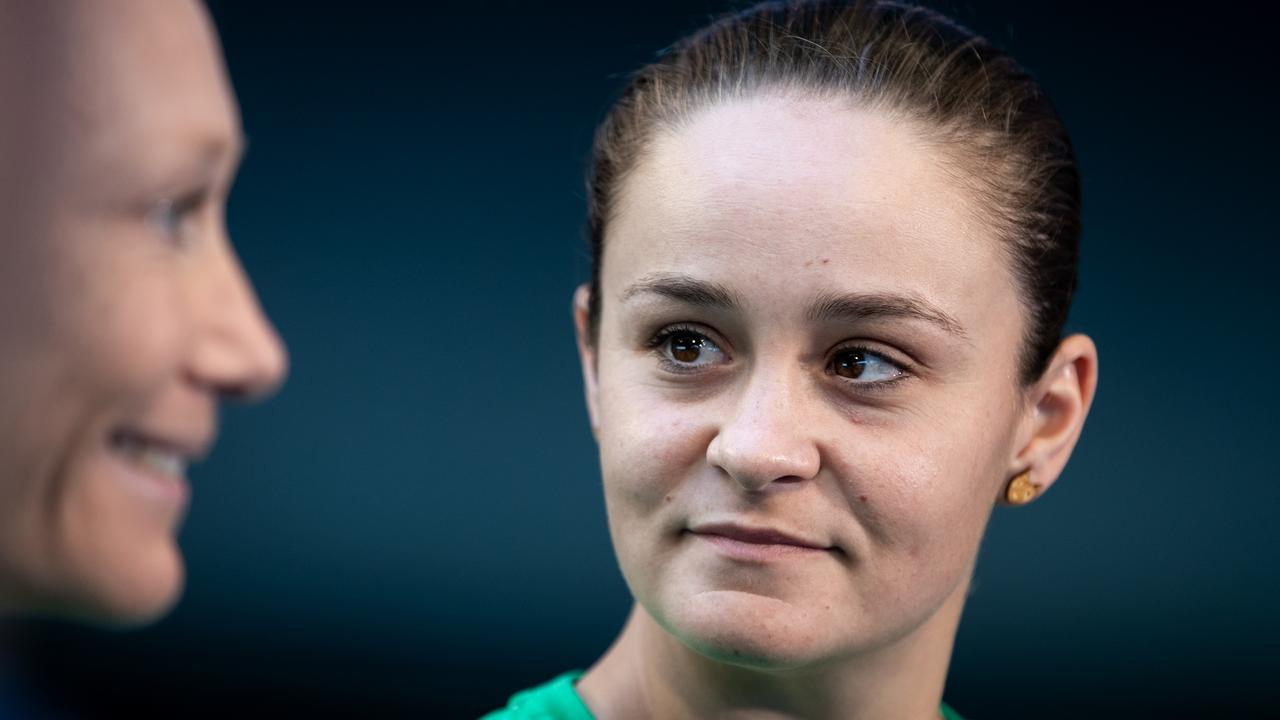 Tennis world No. 1 Ashleigh Barty looks on as Grand Slam champion Samantha Stosur speaks to reporters during a media opportunity ahead of the 2019 Fed Cup at RAC Arena in Perth, Tuesday, November 5, 2019. (AAP Image/Fiona Hamilton) NO ARCHIVING