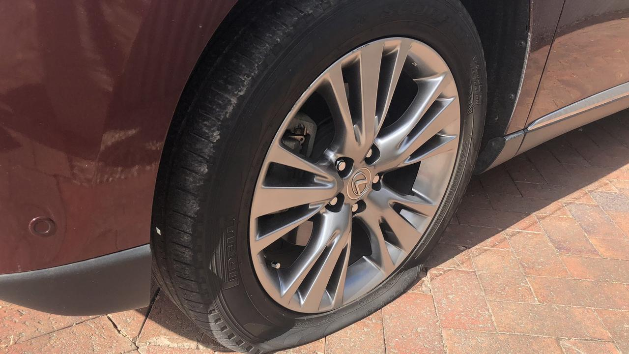 A car with a punctured tyre. Picture: Ben Harvy