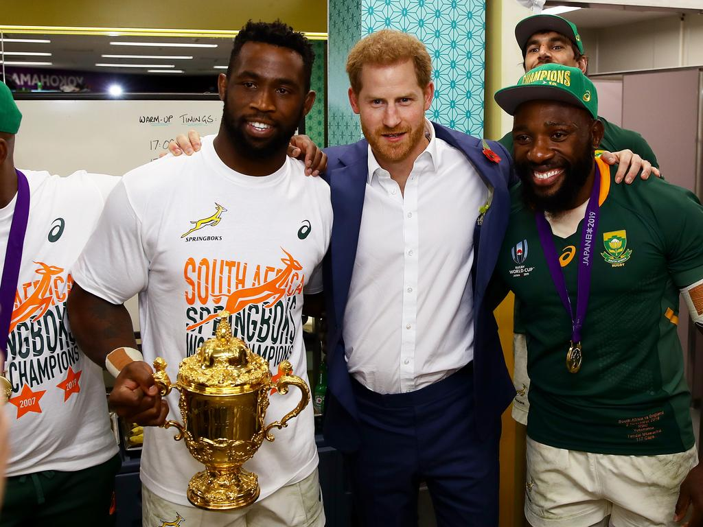 Prince Harry poses for a photo with Siya Kolisi of South Africa holding the Web Ellis cup and Tendai Mtawarira of South Africa. Picture: Getty