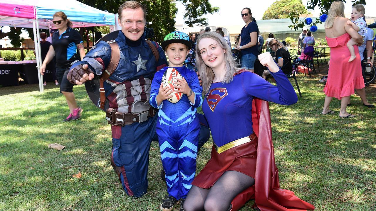 Captain America Ethan Ramsey and Superwoman Eleisha Wilson with Nash Hamann (centre).