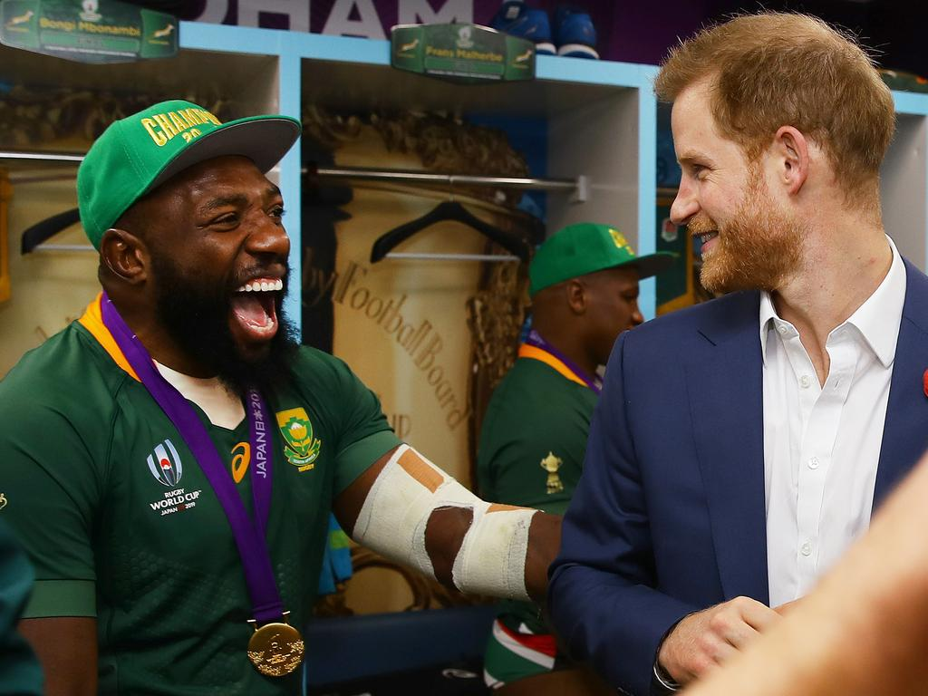 Prince Harry shares a joke with Tendai Mtawarira of South Africa following his team's victory against England in the Rugby World Cup. Picture: Getty