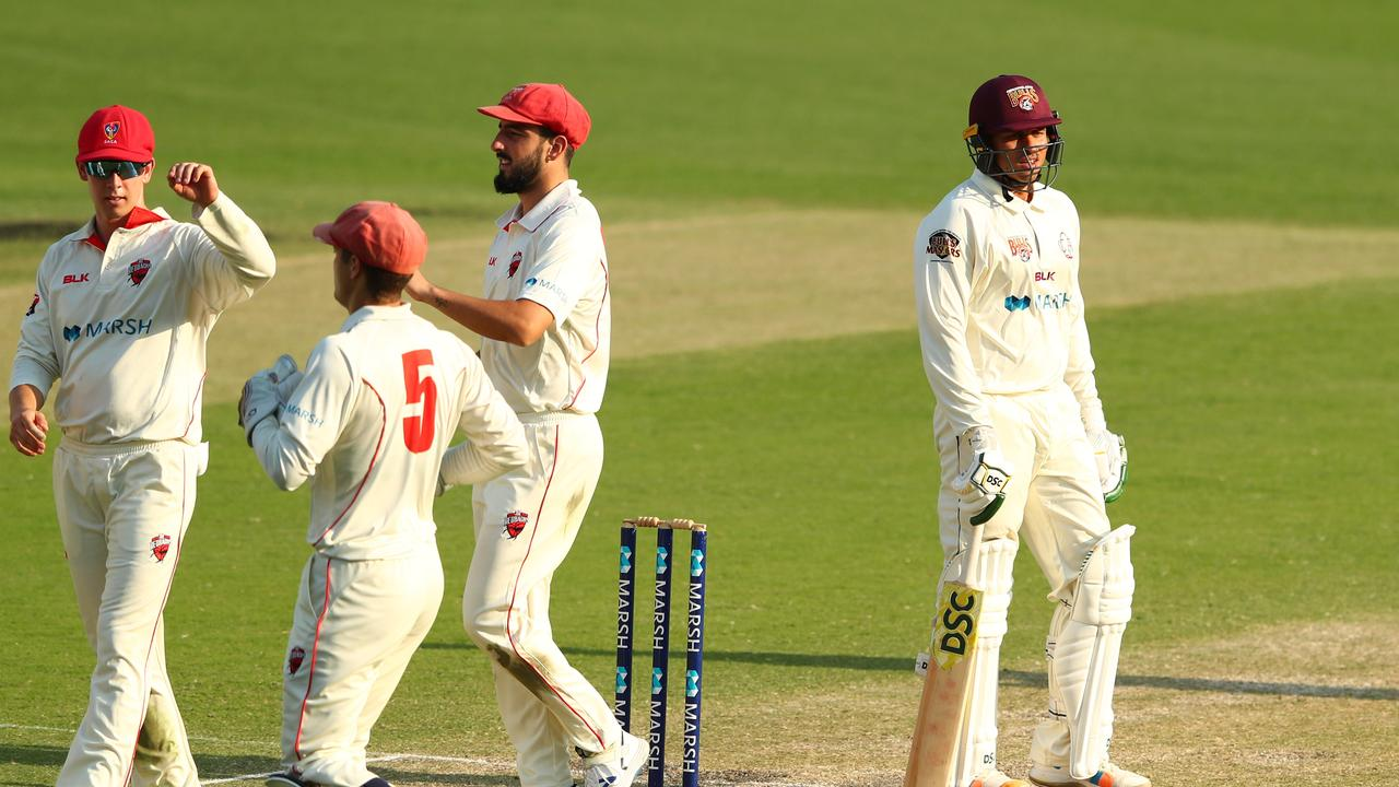 Usman Khawaja departs dejectedly after being dismissed during day three of Queensland's Sheffield Shield win over South Australia. Picture: Chris Hyde/Getty Images