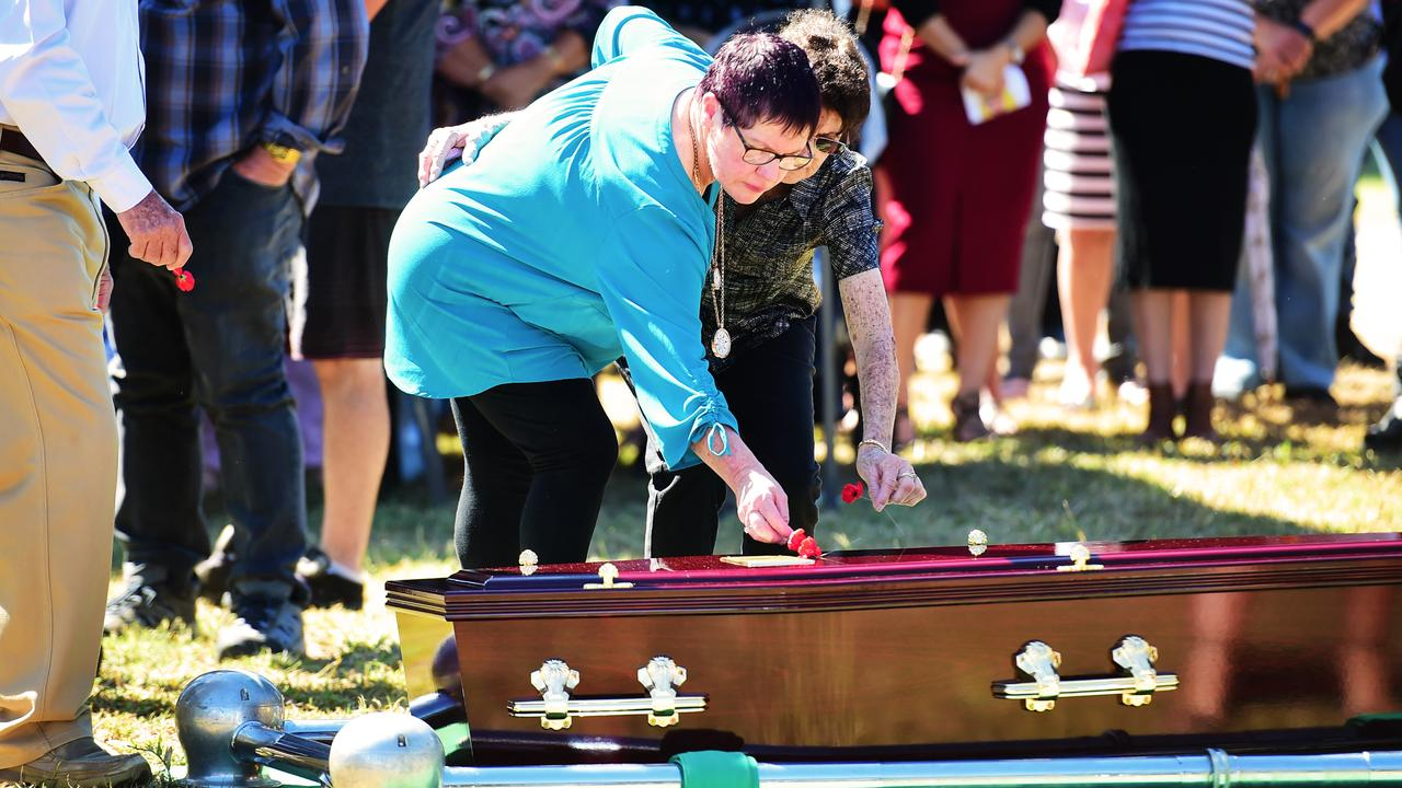 Funeral for army veteran Bradley Carr in Charters Towers, Queensland in May. Glenda Weston, mother of Bradley, lays a poppy on his coffin. Picture: Alix Sweeney