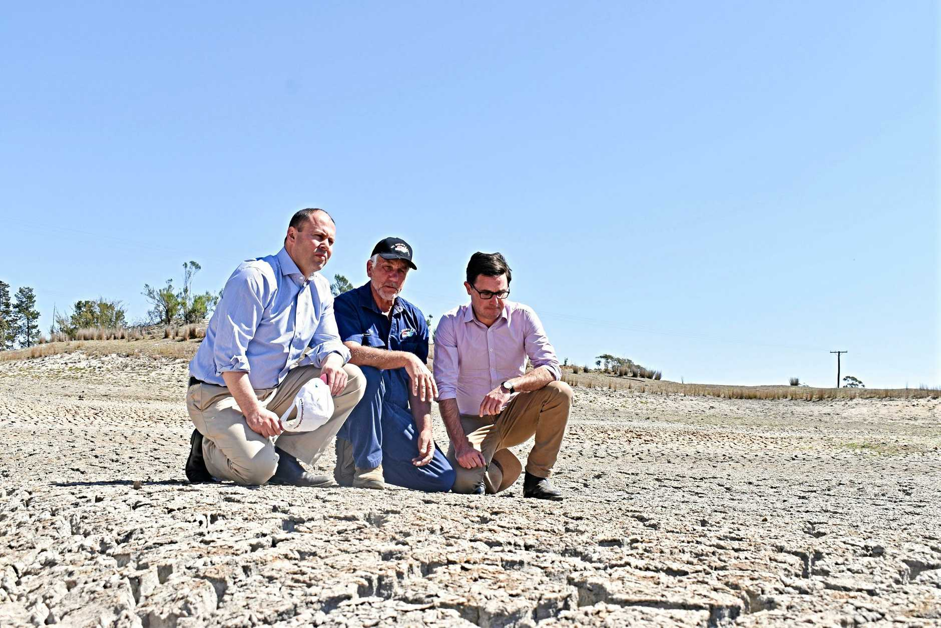 HORROR SIGHT: Granite Belt producer Dino Rizzato shows Federal Treasurer Josh Frydenberg and Minister for Drought David Littleproud the extent of the drought near Stanthorpe.