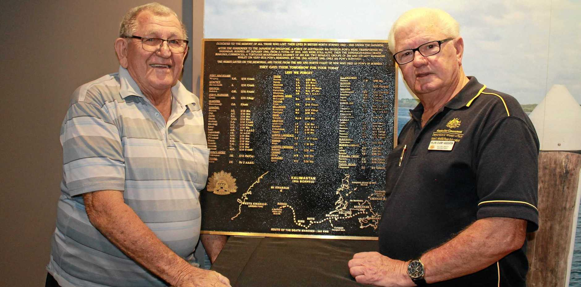 REMEMBRANCE: Vernon Jarrett-Smith with Assistant Curator Ballina RSL Sub-Branch Museum, Allan Britt, with the plaque showing all the names of North Coast POWs who died in the Sandakan march in 1945.