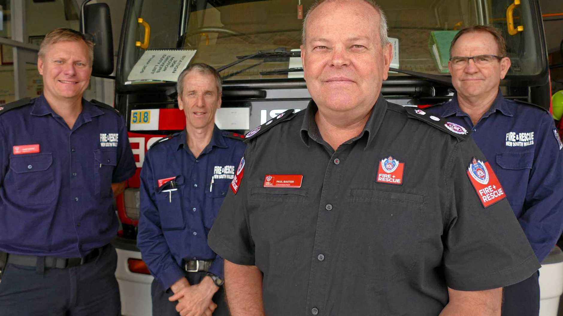 FLEETING VISIT: Fire and Rescue NSW Inspector Gary White, Grafton fire brigade captain Garry Reardon, Fire and Rescue NSW commissioner Paul Baxter and South Grafton brigade captain Paul Danvers at the Grafton Fire Station on Thursday.