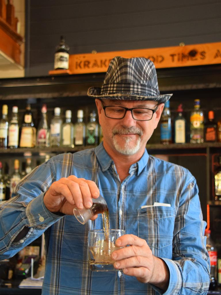 Owner Dave Bjorklund pours a drink behind the bar.
