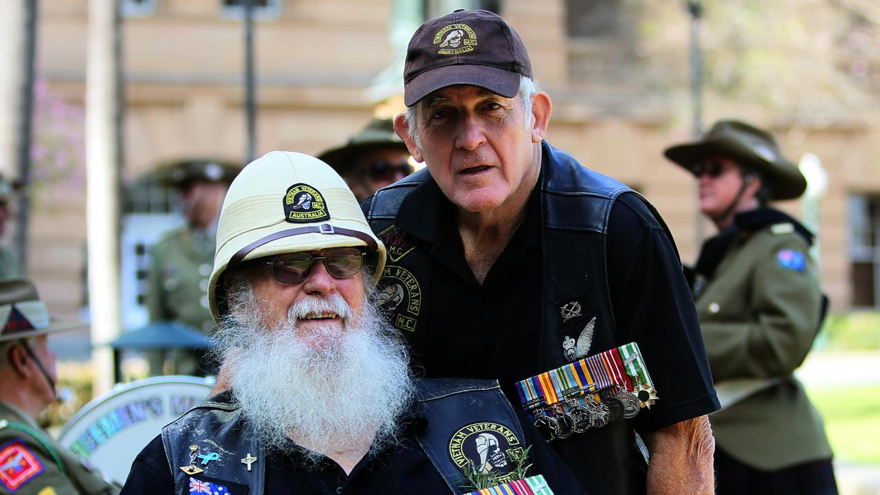 Bob Scott (110 Signals Squadron) and Nigel Longhorn (108 Field Battery lead a Vietnam Veterans Day march in August. PHOTO: AAP Image – Richard Waugh
