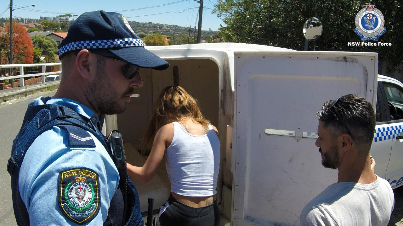 Danielle Hogan gets into a police wagon. Picture: NSW Police