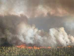 Water bombers battle Teewah blaze as wind shifts