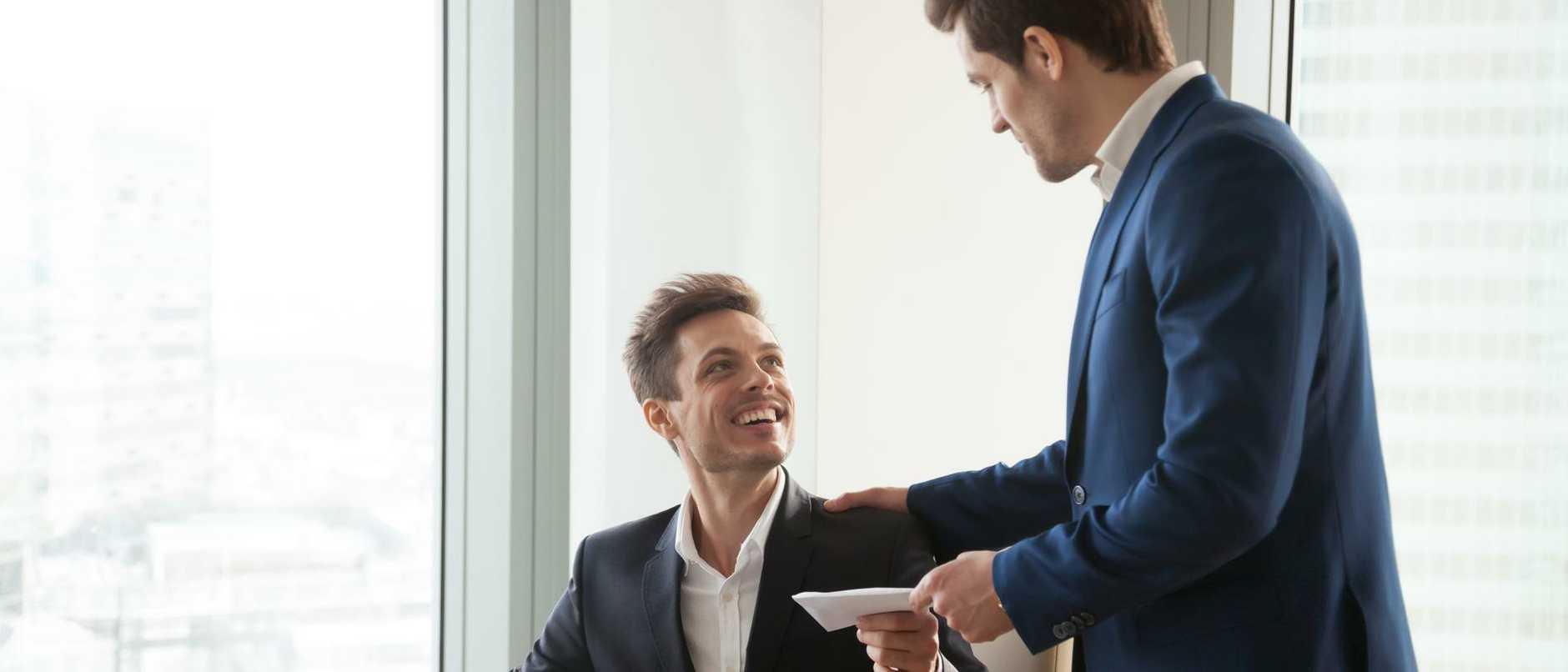 Boss giving money premium to happy employee