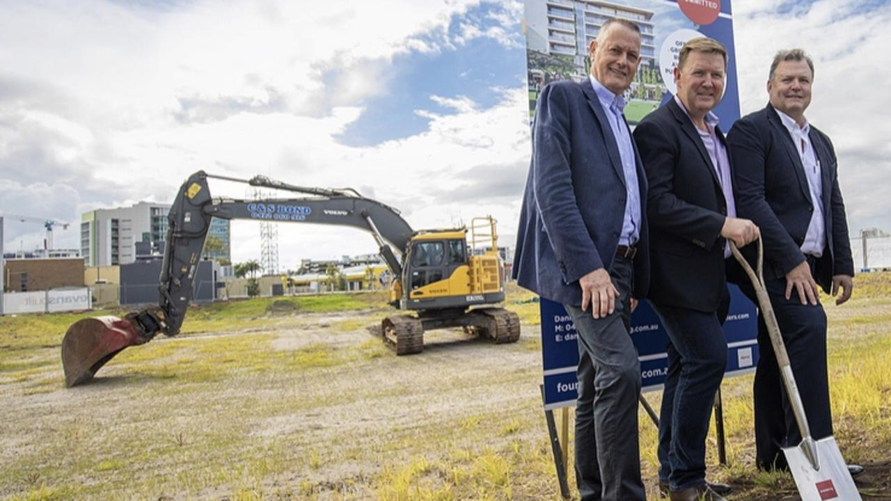 SunCentral Maroochydore chief executive officer John Knaggs, with Dirk Long and Matt Evans, from Evans Long, in the new CBD. Picture: Cade Mooney