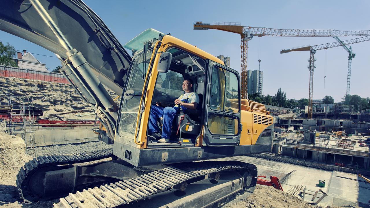 operator operates with  excavator