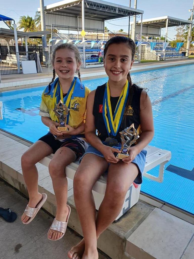 Runner up age champions from the Biloela Aqua Culture Open Preparation Meet, Taylah, 10, and Mila, 8.