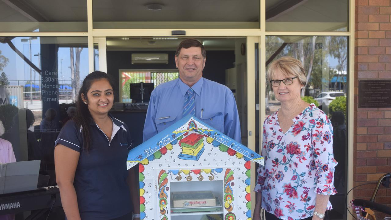 PEN POWER: Debbie Boon and Maya Patel from Blue Care Biloela with Banana Shire Council Mayor Cr Nev Ferrier with the region's first street library.