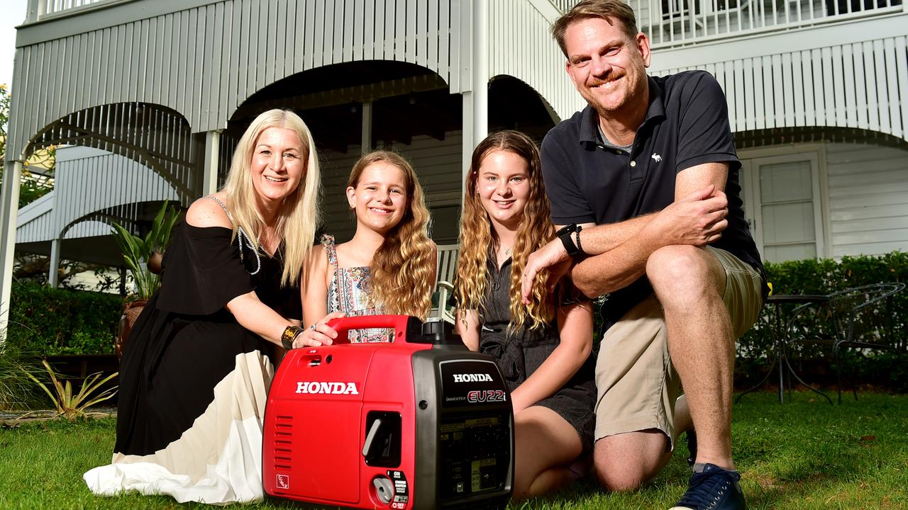 Veronica and Anthony Burke with Vienna,11, and Adelaide, 12, with a Honda EU22i generator.
