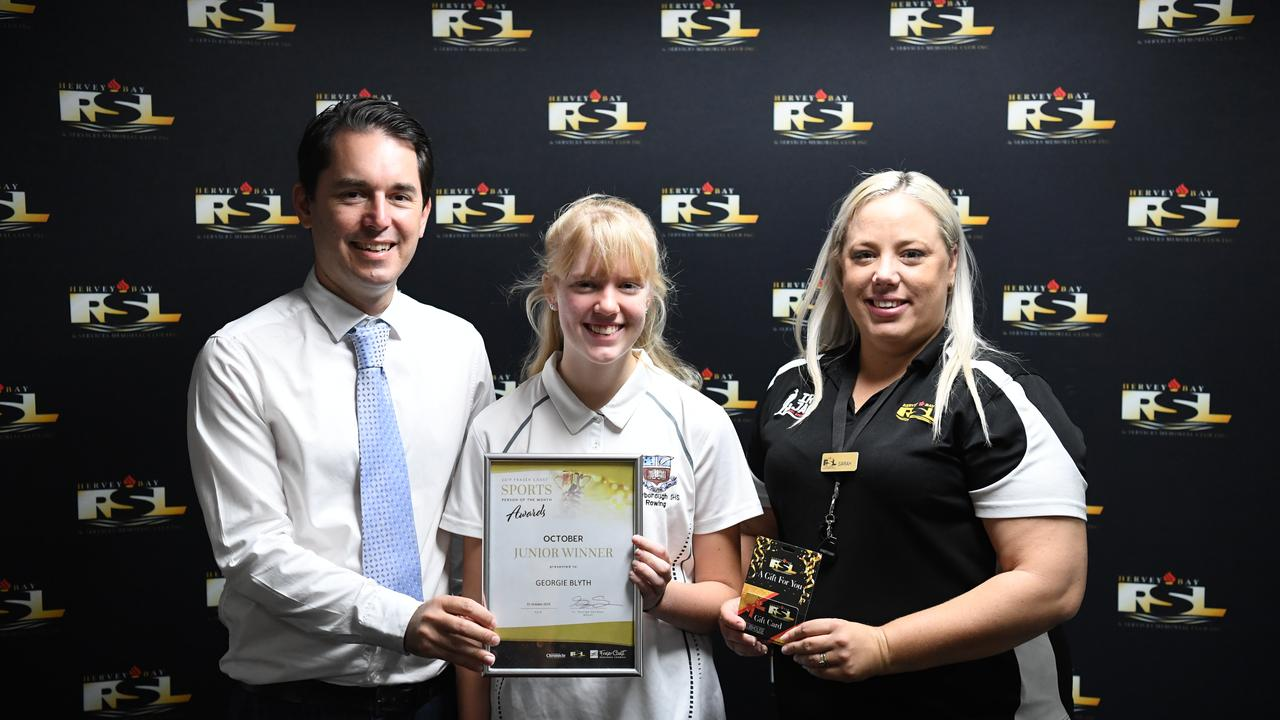 Mayor George Seymour and RSL community engagement officer Sarah Bailey Wilkinson presents Georgie Blyth with her junior sportsperson of the month award.