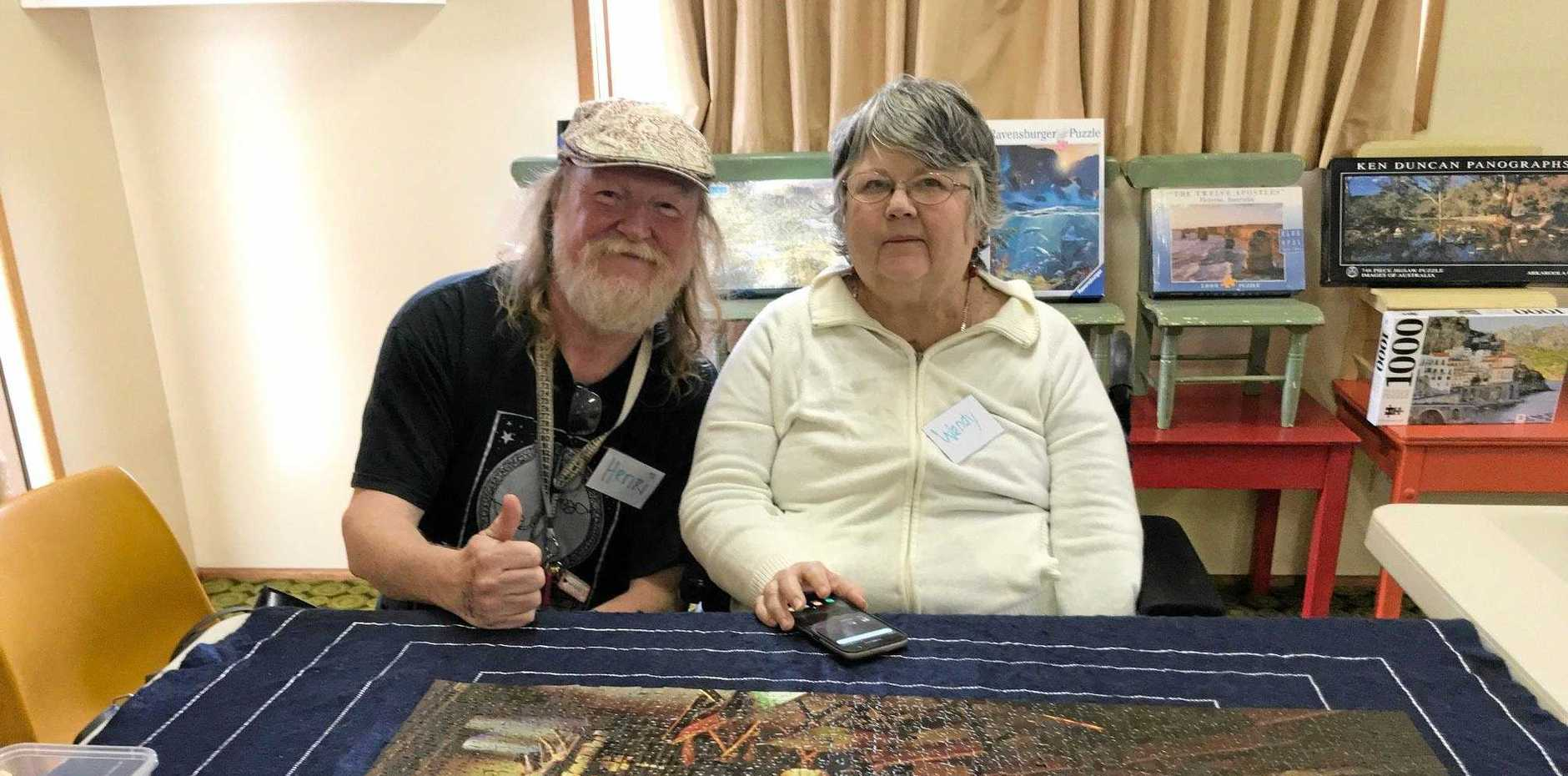 SOCIAL AND CHALLENGING: Henri and Wendy put their minds together to work on solving a puzzle.