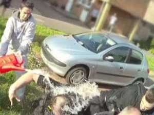 Footage of man dousing cops in petrol