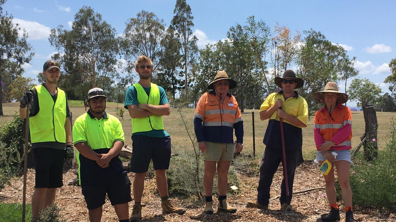 GREEN THUMBS: Employment Plus WDTD Supervisor, Peter Bevan and some of the recent WFTD participants who have contributed to the award-winning Brisbane Valley Rail Trail landscaping project. Photo: Supplied.