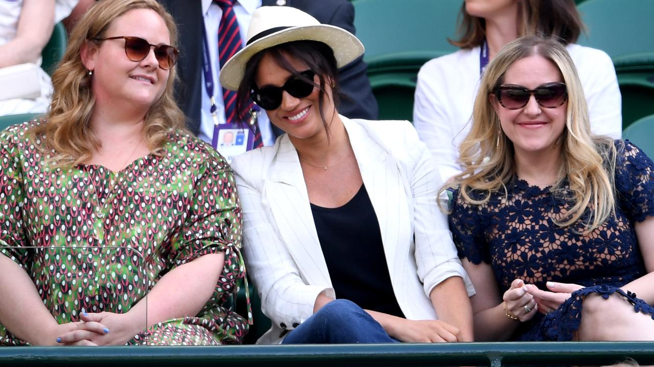 Relaxed royal! Meghan Markle, centre, showed off her Outland Denim jeans at Wimbledon with pals. Picture: Getty Images