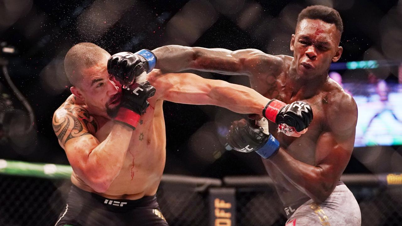 Robert Whittaker trades blows with Israel Adesanya during UFC 243 at Marvel Stadium. Picture: AAP Image/Michael Dodge