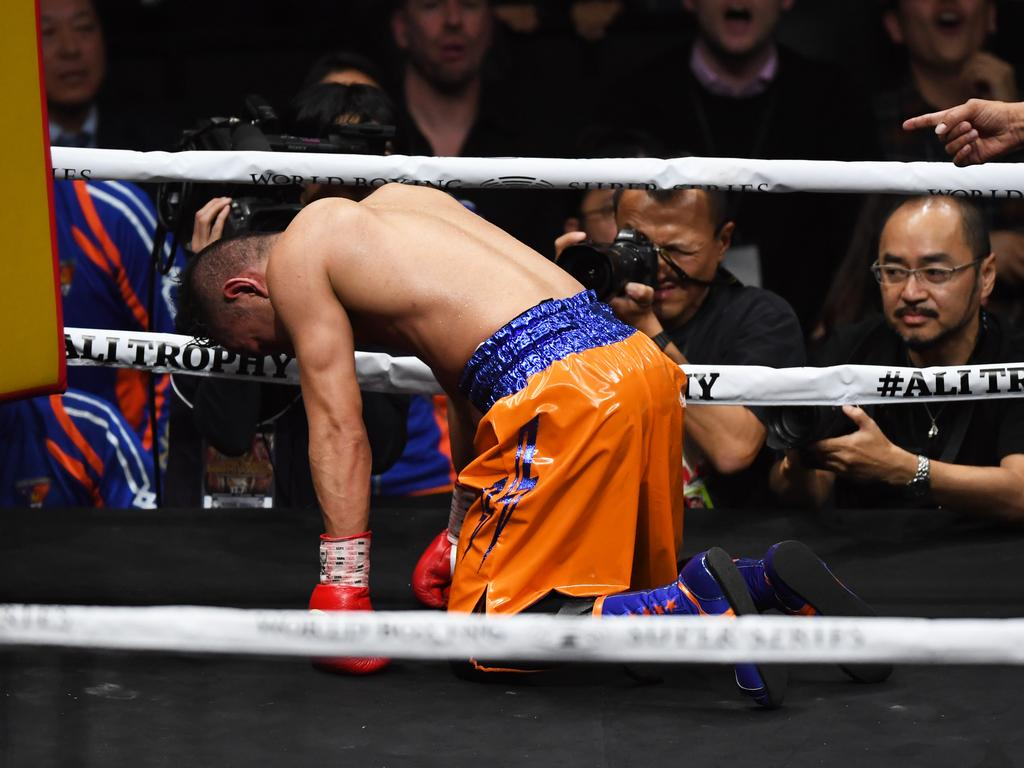 Nonito Donaire tries to beat the count. (Photo by Etsuo Hara/Getty Images)