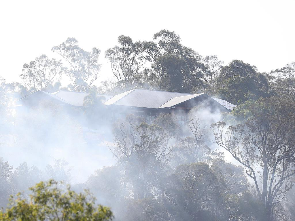 Fire burns perilously close to houses at The Gap. Picture: Annette Dew