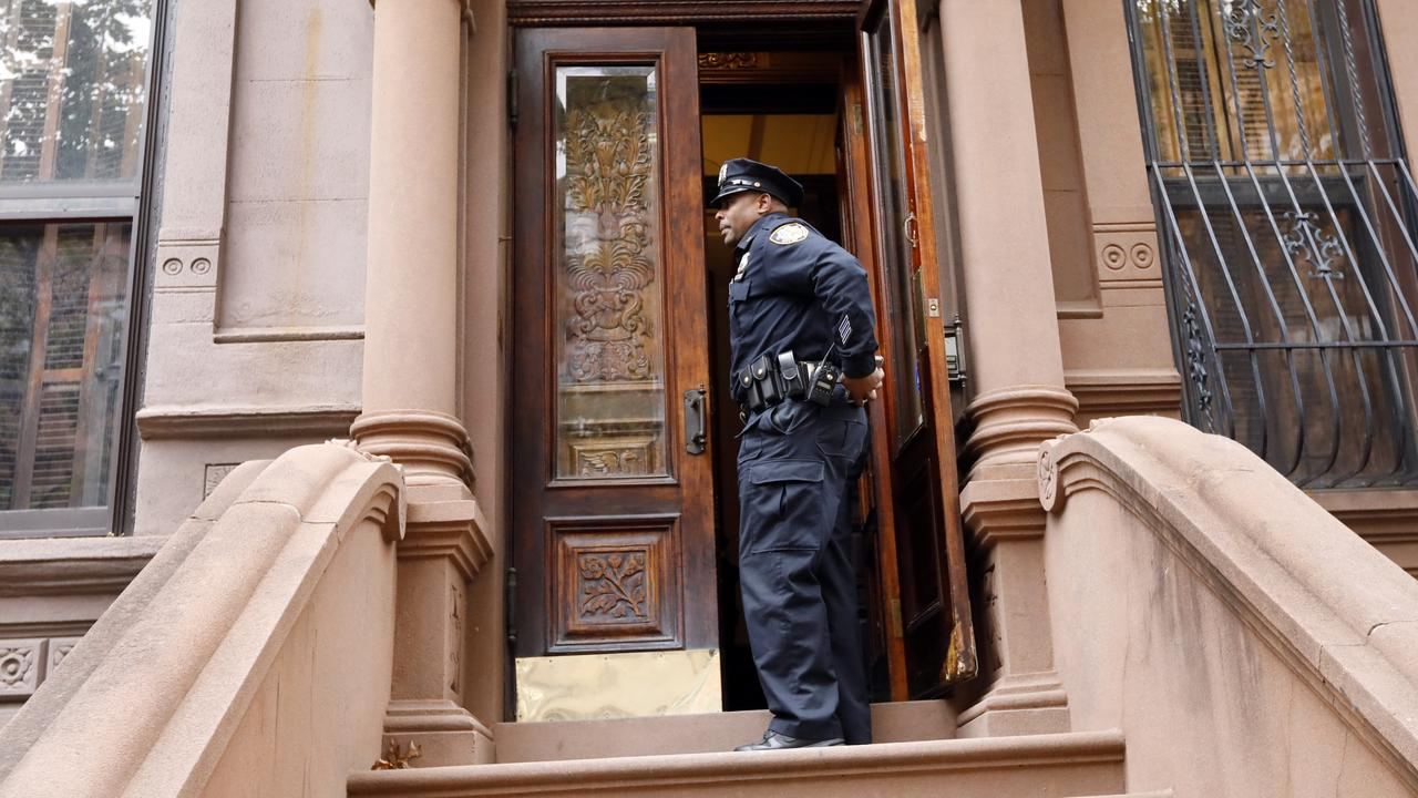 A New York City Police officer stands in the doorway of a residential building in New York's Harlem neighbourhood, Thursday, Nov. 7, 2019. Picture: AP/Richard Drew.