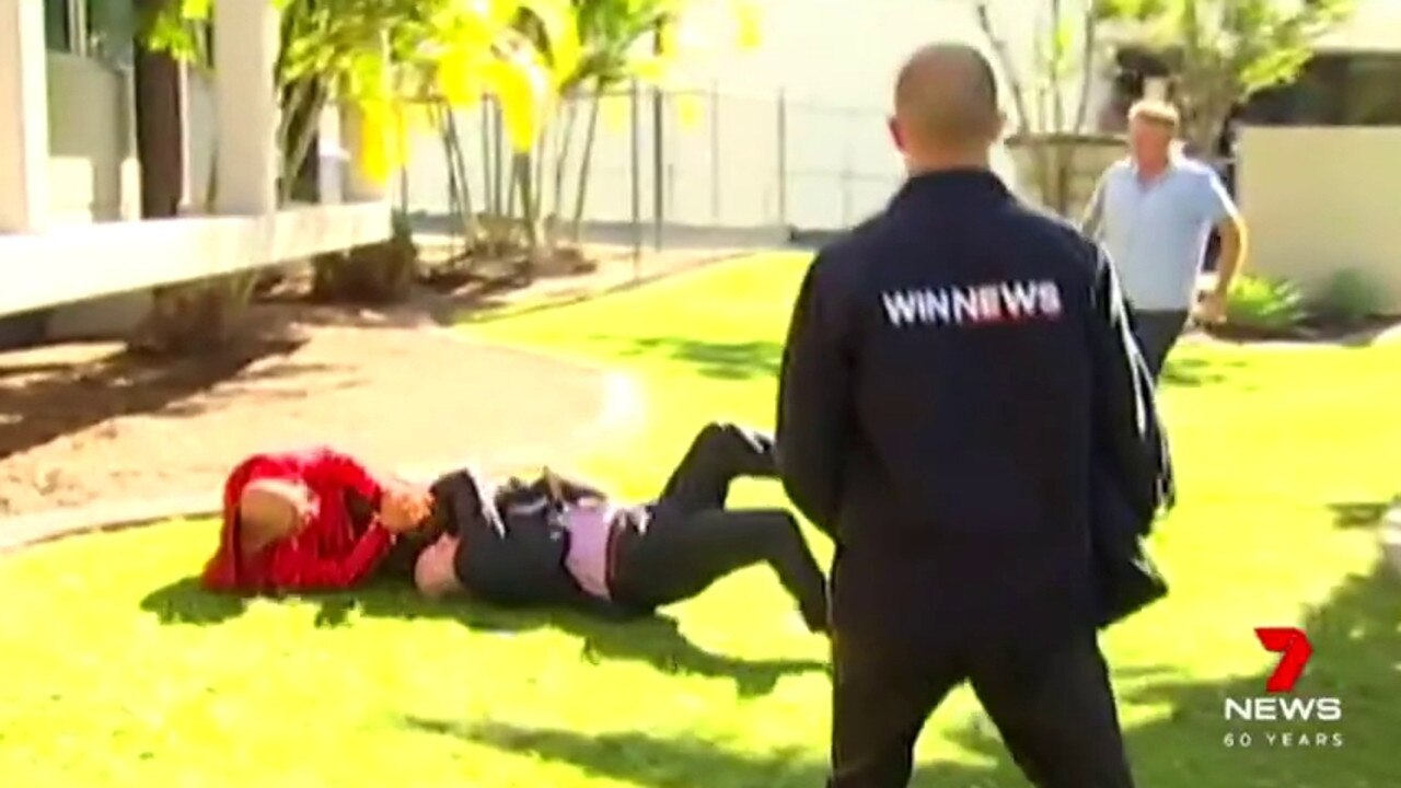 A police press conference on the Sunshine Coast was cut short after a senior detective tackled a man who was running away in the background. Picture: 7News