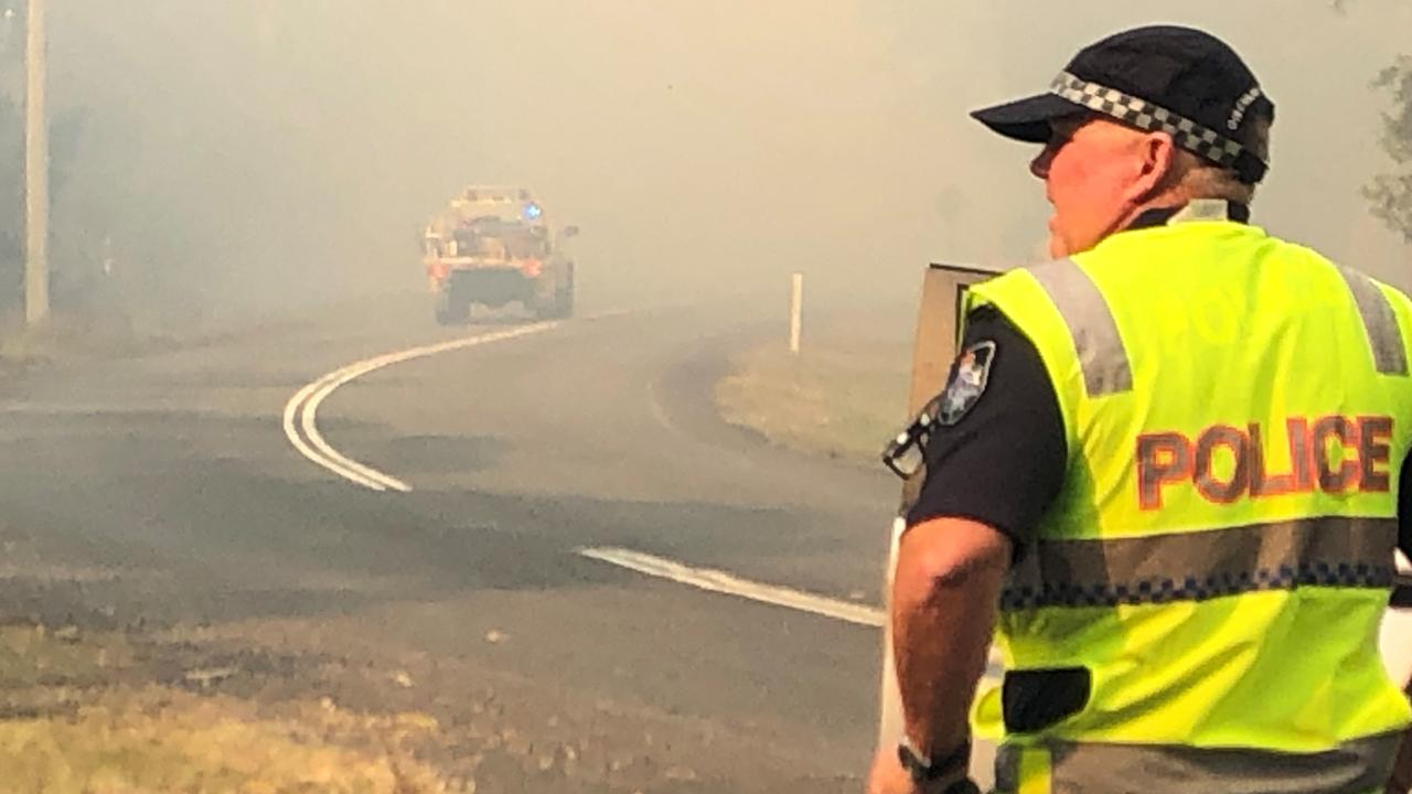 A police officer on the scene of the Cooroibah fire. Photo: Mark Douglas