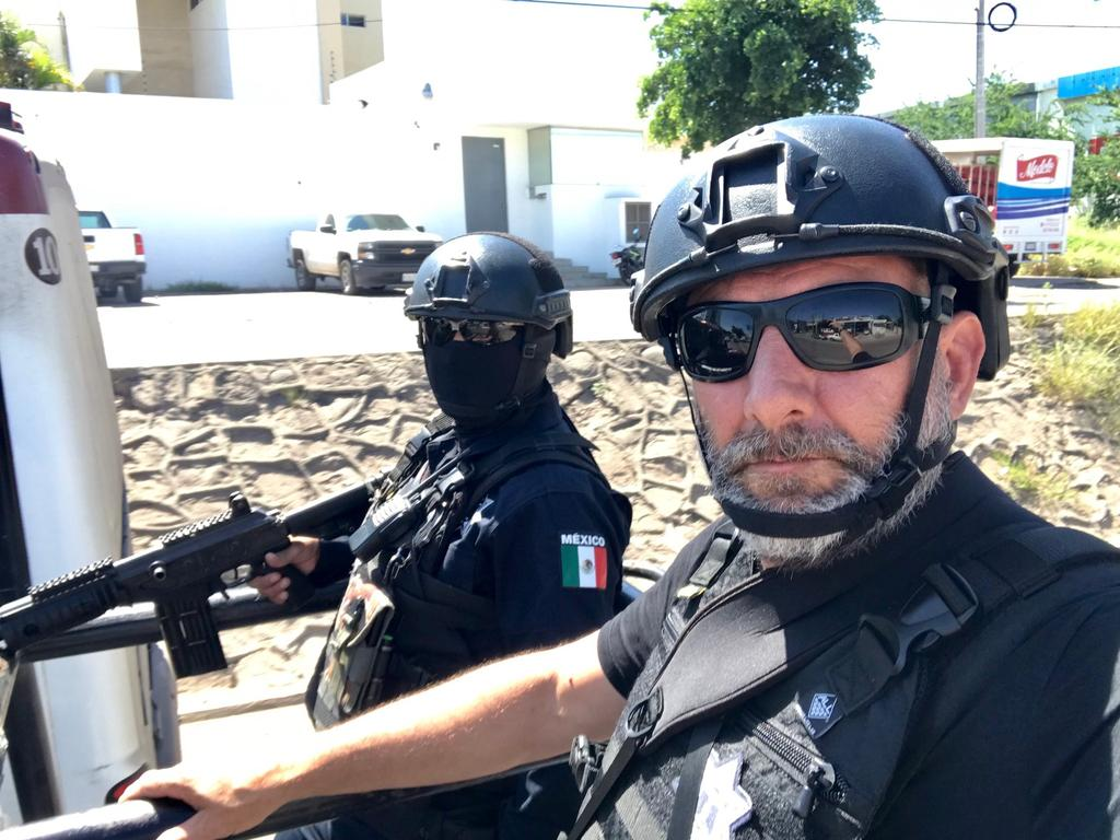 Photographer Nathan Edwards on patrol with the Sinaloa State Police. Picture: Nathan Edwards