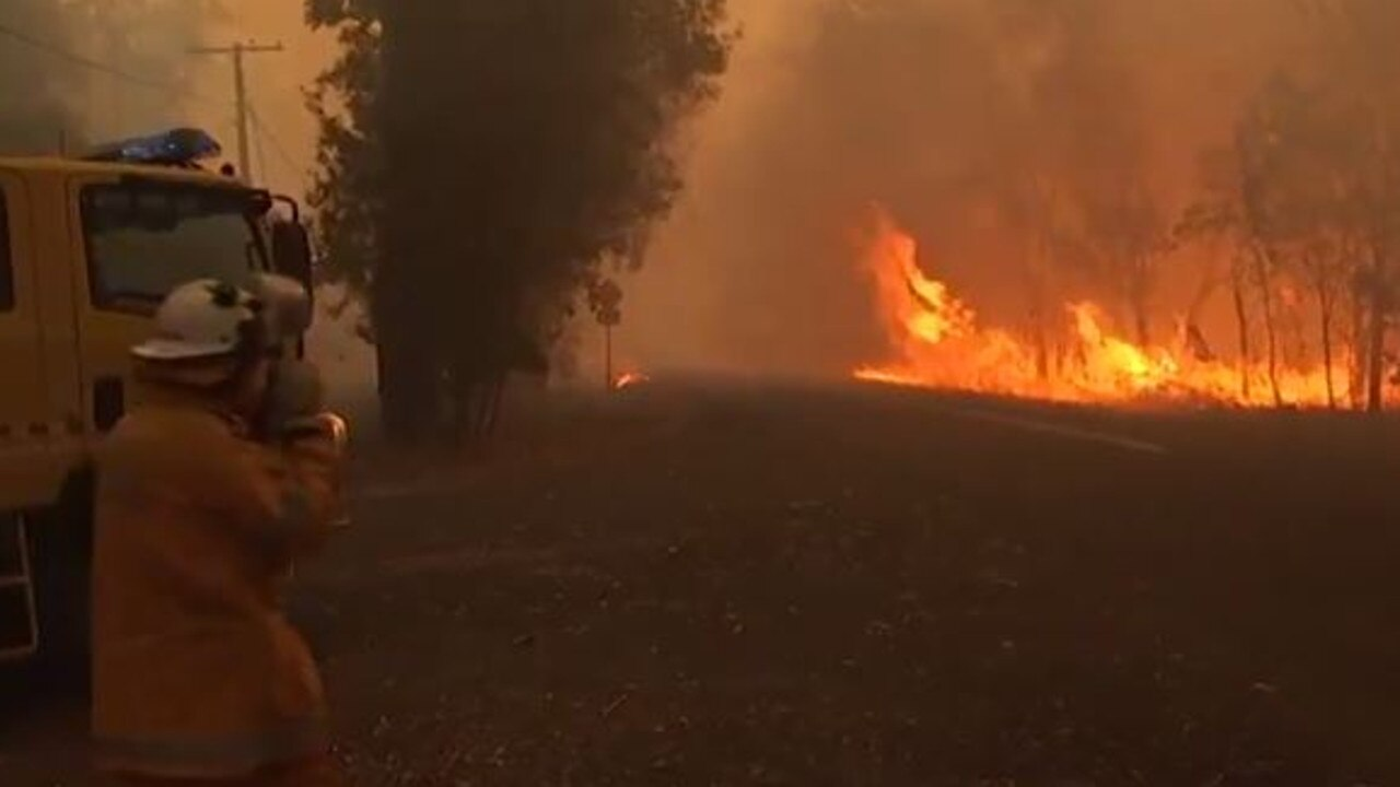 Firefighters are confronted with a blaze at Cooroibah on the Sunshine Coast. Picture: 7 News Sunshine Coast