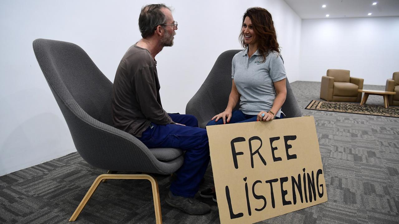 GOOD LISTENER: Emma Ellul listens to Roger Ulmann during a free listening session in Bundaberg.