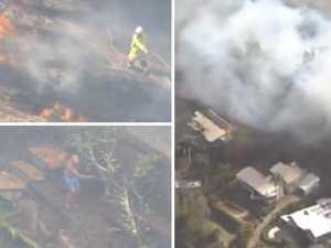 Residents scramble as fire reaches Brisbane's doorstep