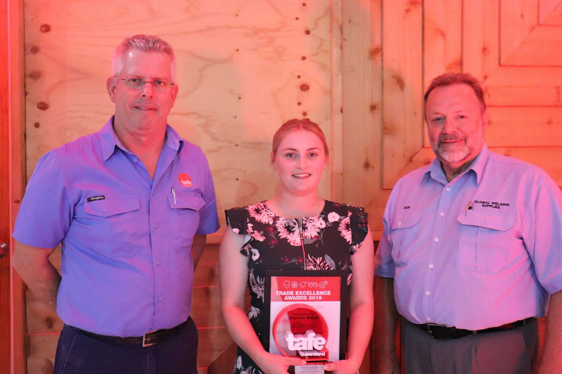 Teacher Tony Croft with Female Trade Student of the Year Shontelle Betzel and Ron Barker from sponsor Global Welding Supplies.
