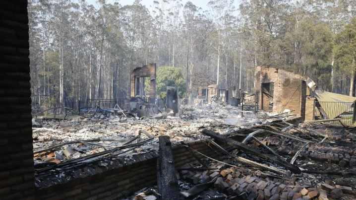 One blaze cut a destructive path through this community near Taree. Picture: AAP