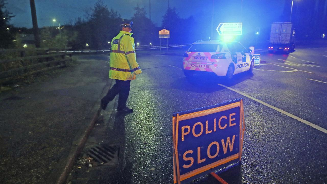 A police roadblock near Meadowhall shopping centre in Sheffield, England, where some people were forced to stay overnight after heavy rain and flooding caused local roads to become gridlocked. Picture: AP
