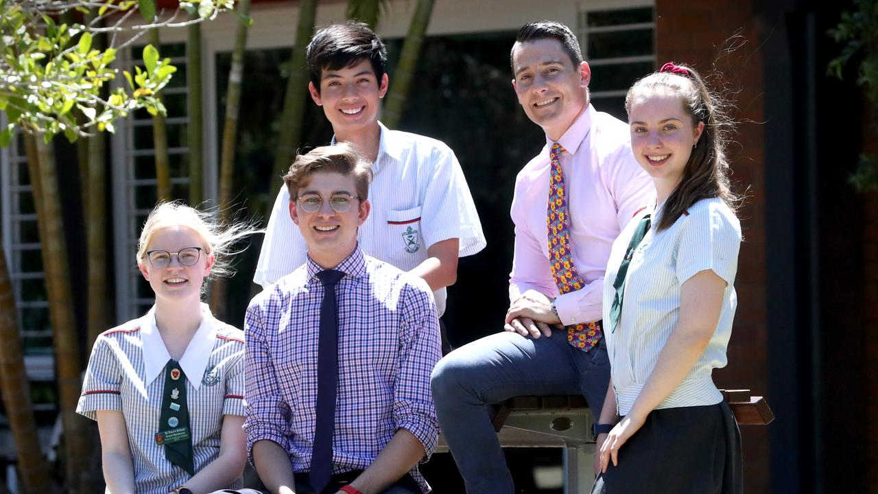 St Paul's School Bald Hills second-year teachers Chris Holley and Nathan Woods with students (from left) Gracielle Manderson, Marcus Weller and Jessica Gentle. They have bucked the trend as the number of male teachers in Queensland declines. Picture: Jamie Hanson