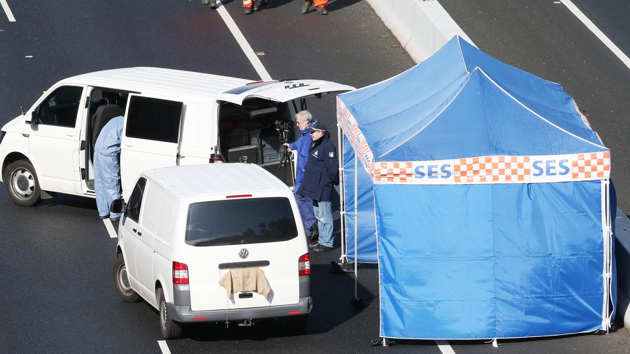 A bullet ridden van abandoned in the middle of a major freeway led to police to a grisly discovery. Picture: David Crosling