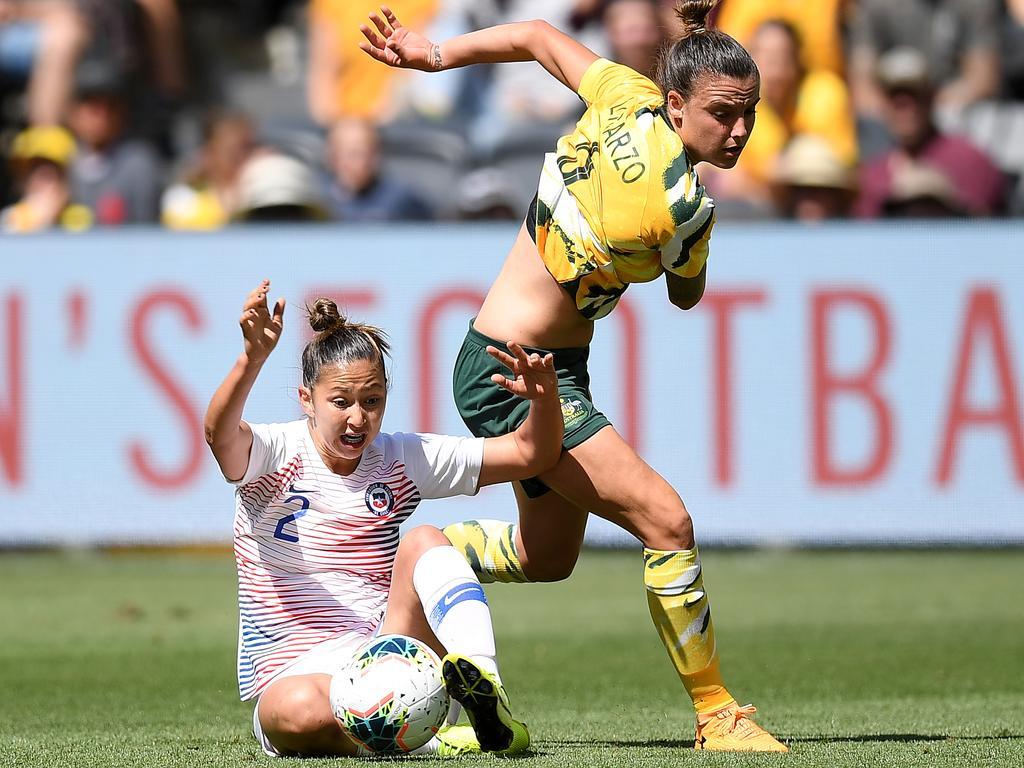 Chile's Rocio Soto tackles Matildas star Chloe Logarzo. Picture: AAP