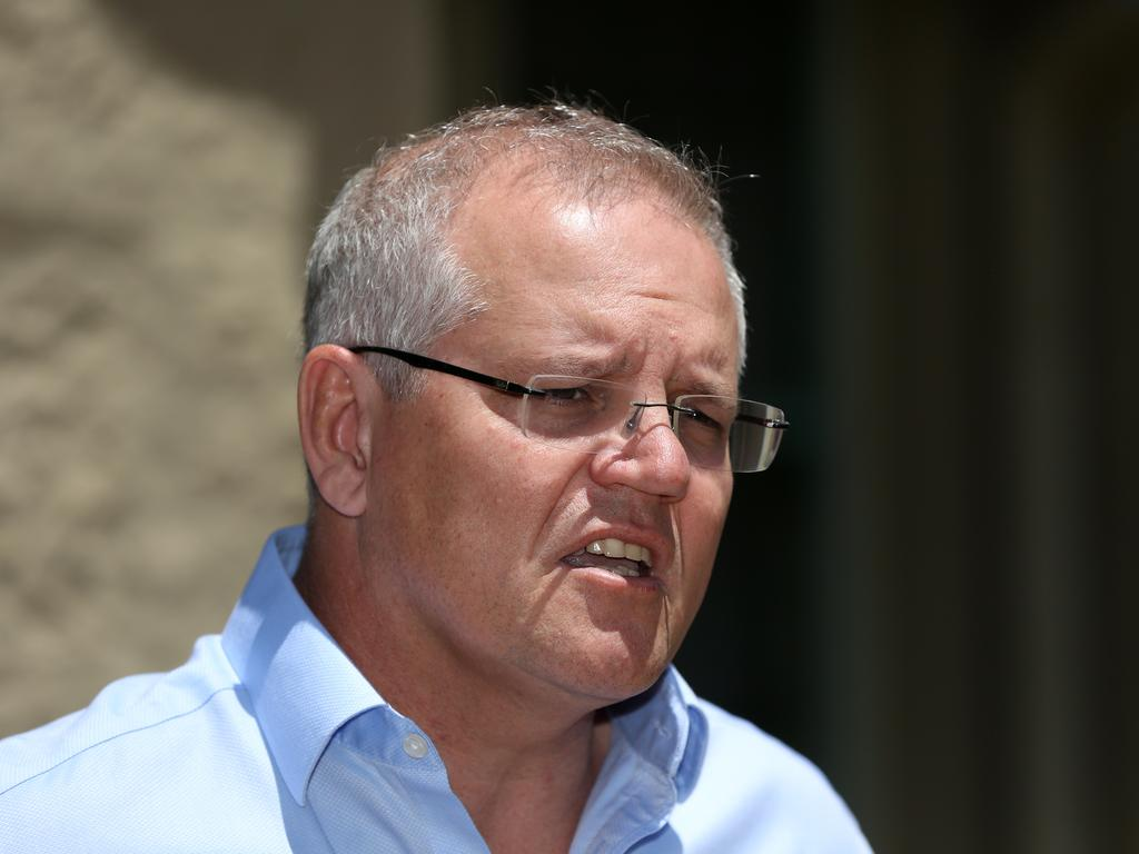 Scott Morrison declined to address questions about whether this year's unprecedented fires were linked to global warming yesterday. Picture: Danny Casey