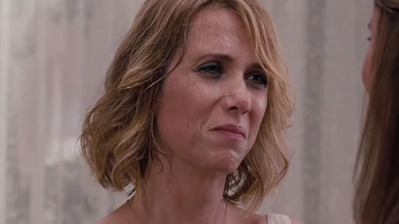 Kristen Wiig's character did her best to pretend she wasn't sick.