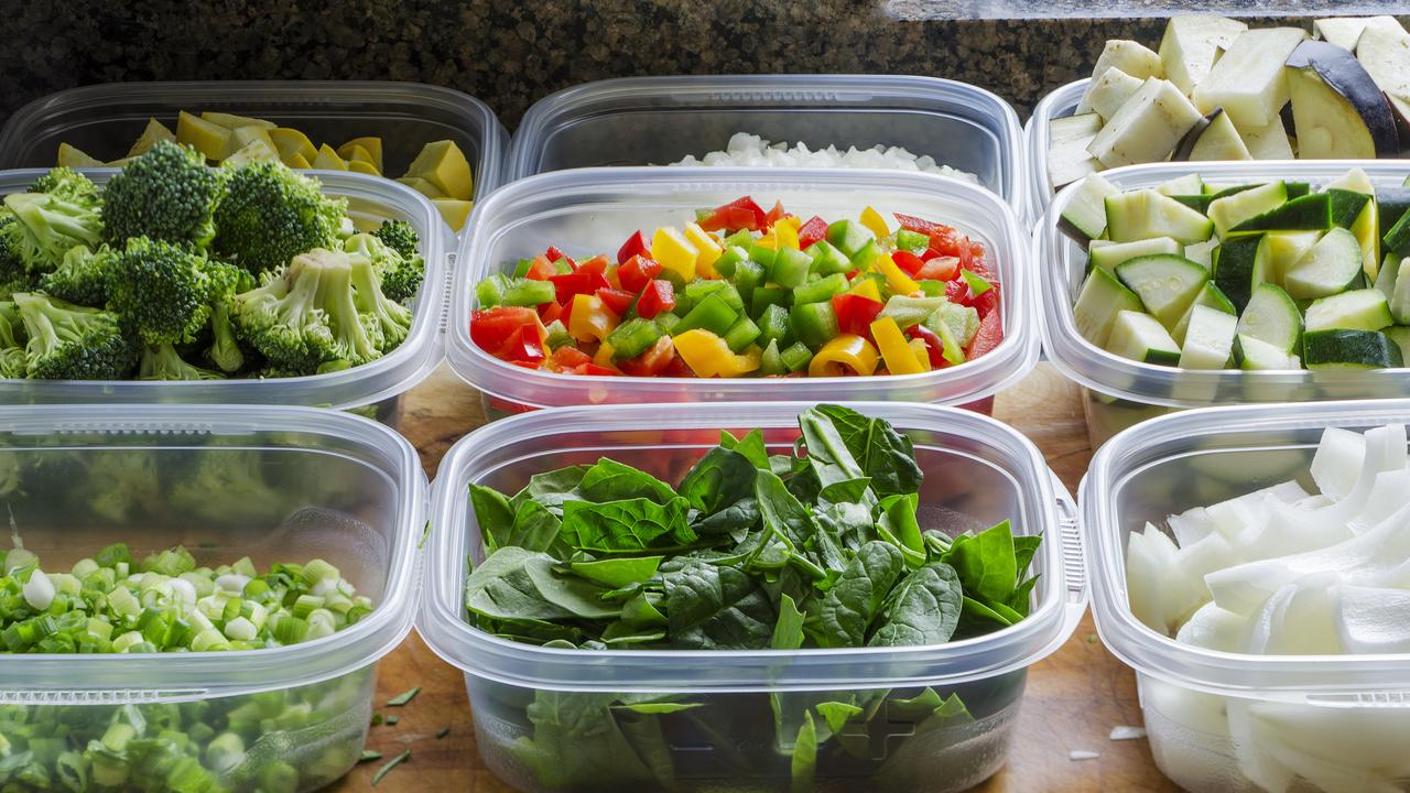 Staff would clean the reusable containers before filling them with food.
