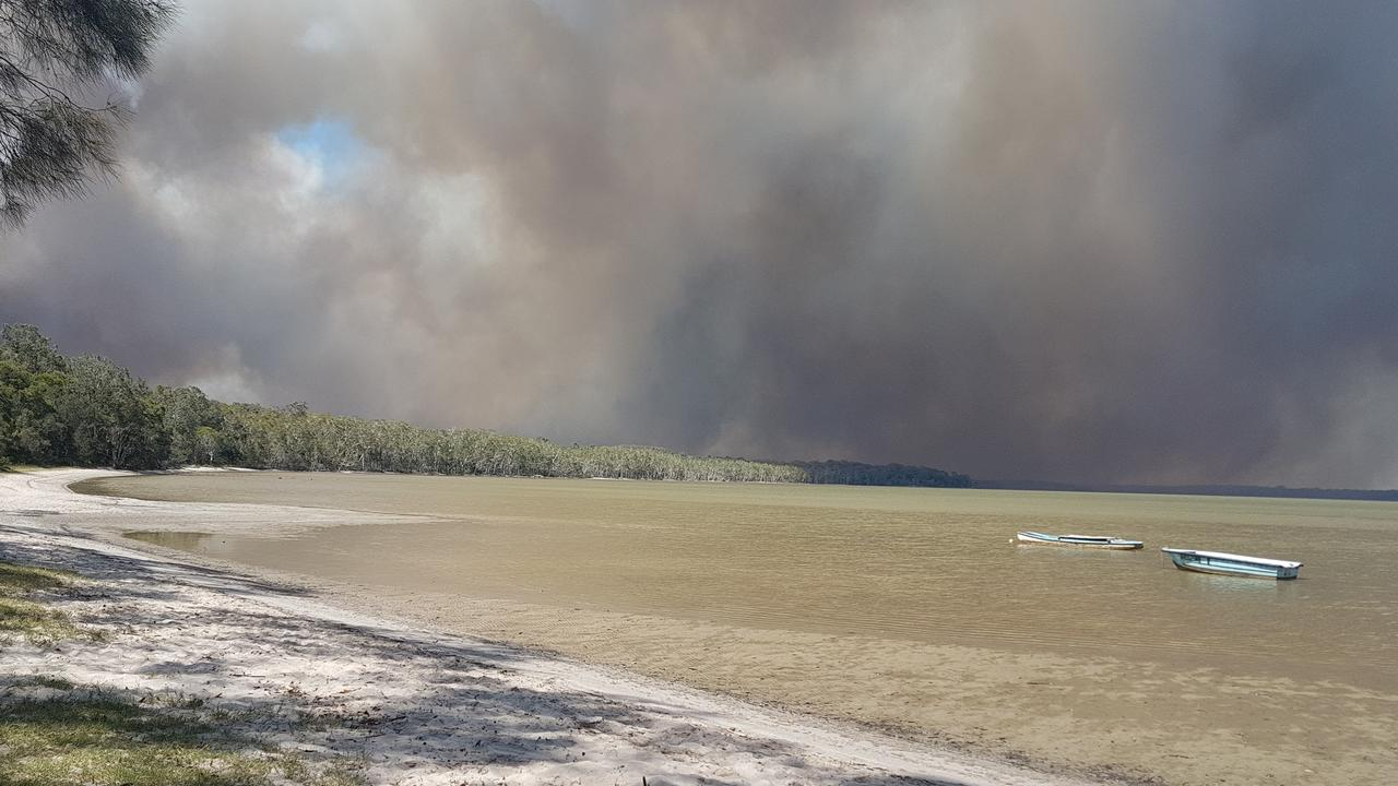 A bushfire rages towards Lake Cooroibah on Friday afternoon. Picture: Ian Kerley.